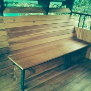 wooden seating at treehouse