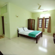 August residency wayanad bedroom